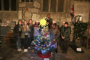 "Group from Providence house standing behind thier ""Jamaican"" Christmas Tree"