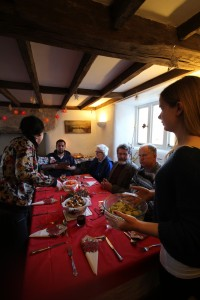 Some of the older members of the community having Christmas lunch at the farm